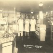 Buchholtz Grocery.  Where was this located?  Do you recognize the men in the picture?  Who are they?